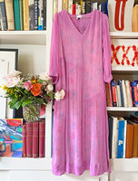 Mid length dress with asymmetrical skirt gathers and contrast floral slip  image